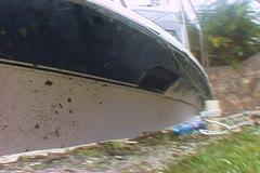 Hurricane smashes fishing boat - stock footage