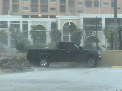Truck almost goes airborne during Hurricane Stock Footage
