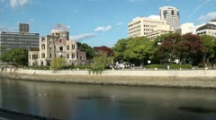 Contrast in Hiroshima - the Atomic Bomb Dome and new office buildings - stock footage