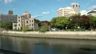 Contrast in Hiroshima - the Atomic Bomb Dome and new office buildings Stock Footage