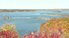 Car Crosses Between Lakes in Fall Season Stock Footage
