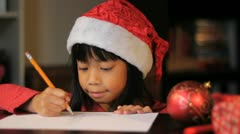 Cute Six Year Old Drawing Picture For Santa Claus-Close Up Stock Footage