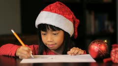 Cute Six Year Old Drawing Picture For Santa Claus Stock Footage