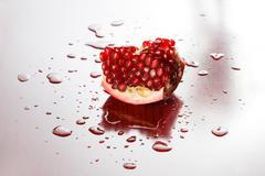 studio shot of pomegranate. - stock photo