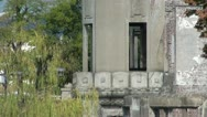 Zooming out of the 'Atomic Bomb Dome' building in Hiroshima Stock Footage