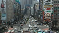 Stock Video Footage of Shinjuku Neon Sign Busy Shopping Street Tokyo Japan Day Traffic Crowds Tokio