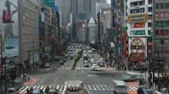 Shinjuku Neon Sign Street, Shopping Area in Tokyo, Japan, Day Traffic Crowds - stock footage
