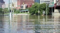 Flooding along a street leading to a neighborhood Stock Footage