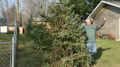 Setting up Holiday Lawn Decorations Stock Footage