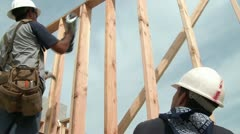 Construction Worker Using Nail Gun & Hammering - stock footage