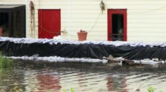 Sandbags protecting a home against rising flood waters Stock Footage
