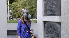 Girl in gas masks comes with a carrying case Stock Footage