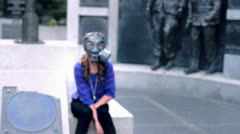 girl in gas masks, hitting the camera - stock footage