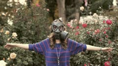 Girl in gas masks around the rose Stock Footage