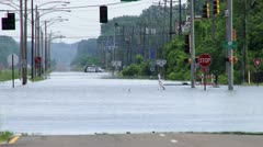 Flooded intersection due to record rains Stock Footage
