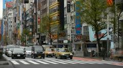 Shinjuku Neon Sign Street, Shopping Area in Tokyo, Japan, Day Traffic time lapse Stock Footage