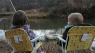 Little kids fishing by the River Stock Footage