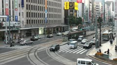 Trams, cars, and other traffic in downtown Hiroshima Stock Footage
