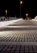 empty stone pavement at night - stock photo