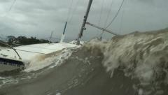 grounded sailboat taking on water as hurricane approaches - stock footage