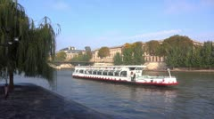 Tourist boat sailing on the Saine in Paris Stock Footage