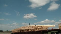 Crane Lifts Wood Framing into Air Stock Footage