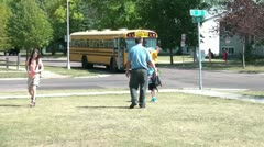 Dad Meets Kids Off Bus After School Stock Footage