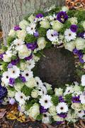 sympathy wreath in white and purple - stock photo