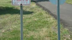 Dog Waste Sign Fine - No Motorized Vehicles Stock Footage