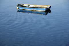 Boat and calm blue sea Stock Photos