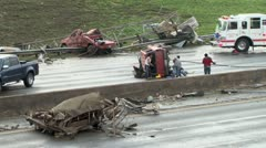 Wrecked vehicles and debris on highway from a violent tornado Stock Footage