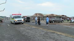 ambulance maneuvers around debris to help tornado victims - stock footage