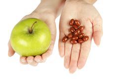 Natural vitamins versus artificial Stock Photos