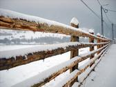 Stock Photo of Wooden fence covered by snow