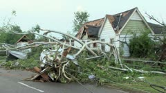 Downed power lines and damaged homes from a tornado Stock Footage
