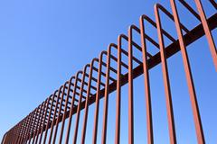 Fence with bent metal rods Stock Photos