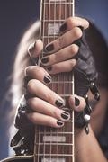 Stock Photo of Girl holding her guitar