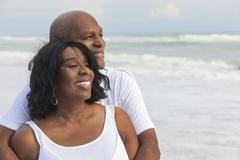 happy senior african american couple on beach - stock photo