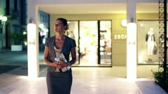 Elegance lady walking in shopping center in the evening - stock footage
