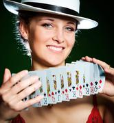 Girl and playing cards Stock Photos