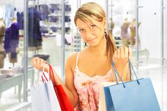 Stock Photo of girl with bags - comparison shopping. sale!