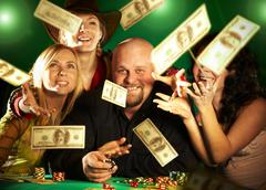 Cheerful company of friends. prize of money. Stock Photos