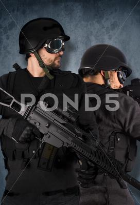 Stock photo of two soldiers, swat and police concept