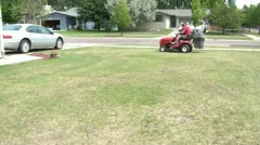 Father and Son on Riding Lawnmower Stock Footage