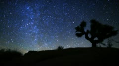 Amazing galaxy stars circling Joshua Tree Timelapse. Pink clouds lead to sunset Stock Footage