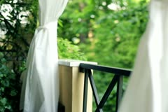 Young woman relaxing after shower on balcony - stock footage