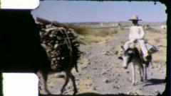 Man Rides BURRO DONKEY Mexico Desert 1940s (Vintage Film Home Movie) 5864 Stock Footage