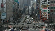 Stock Video Footage of Shinjuku Neon Sign Street, Shopping Area in Tokyo, Japan, Day Traffic Crowds