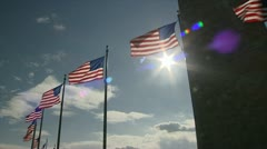 USA stars and stripes flag at the Washington monument Stock Footage