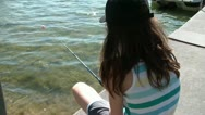 Girl Fishing Off of Dock Stock Footage